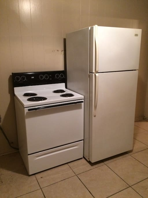 Kitchen with oven, microwave and refridgerator