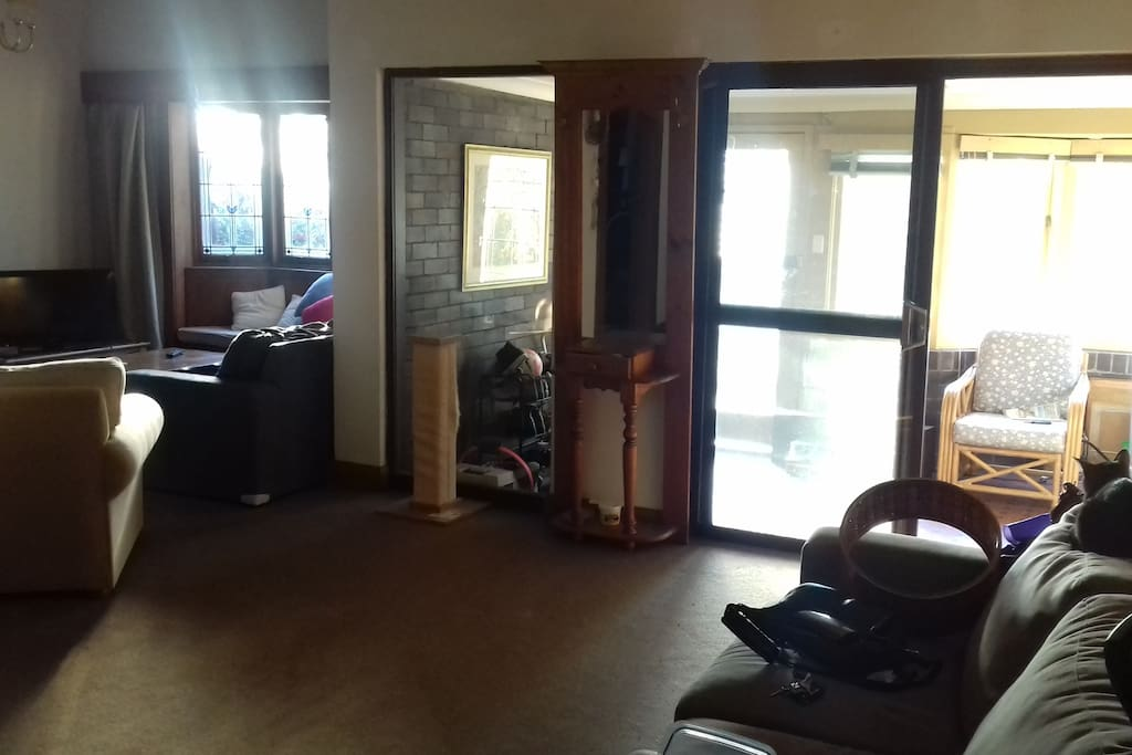 Entry room and living room with tv