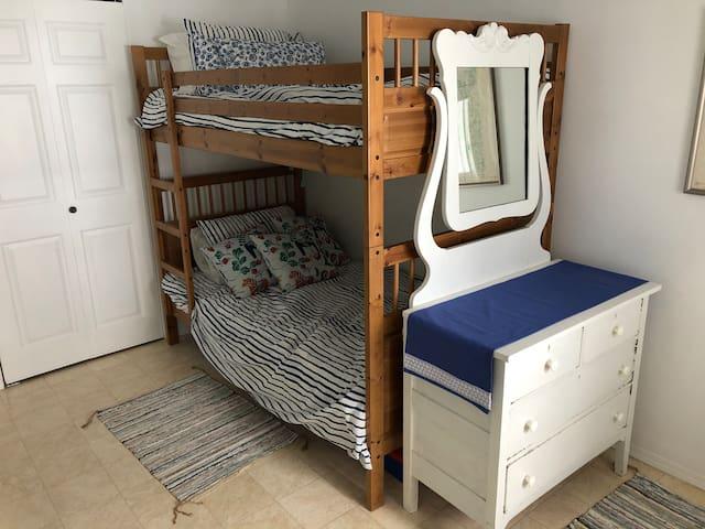 Blue bedroom bunkbed and dresser