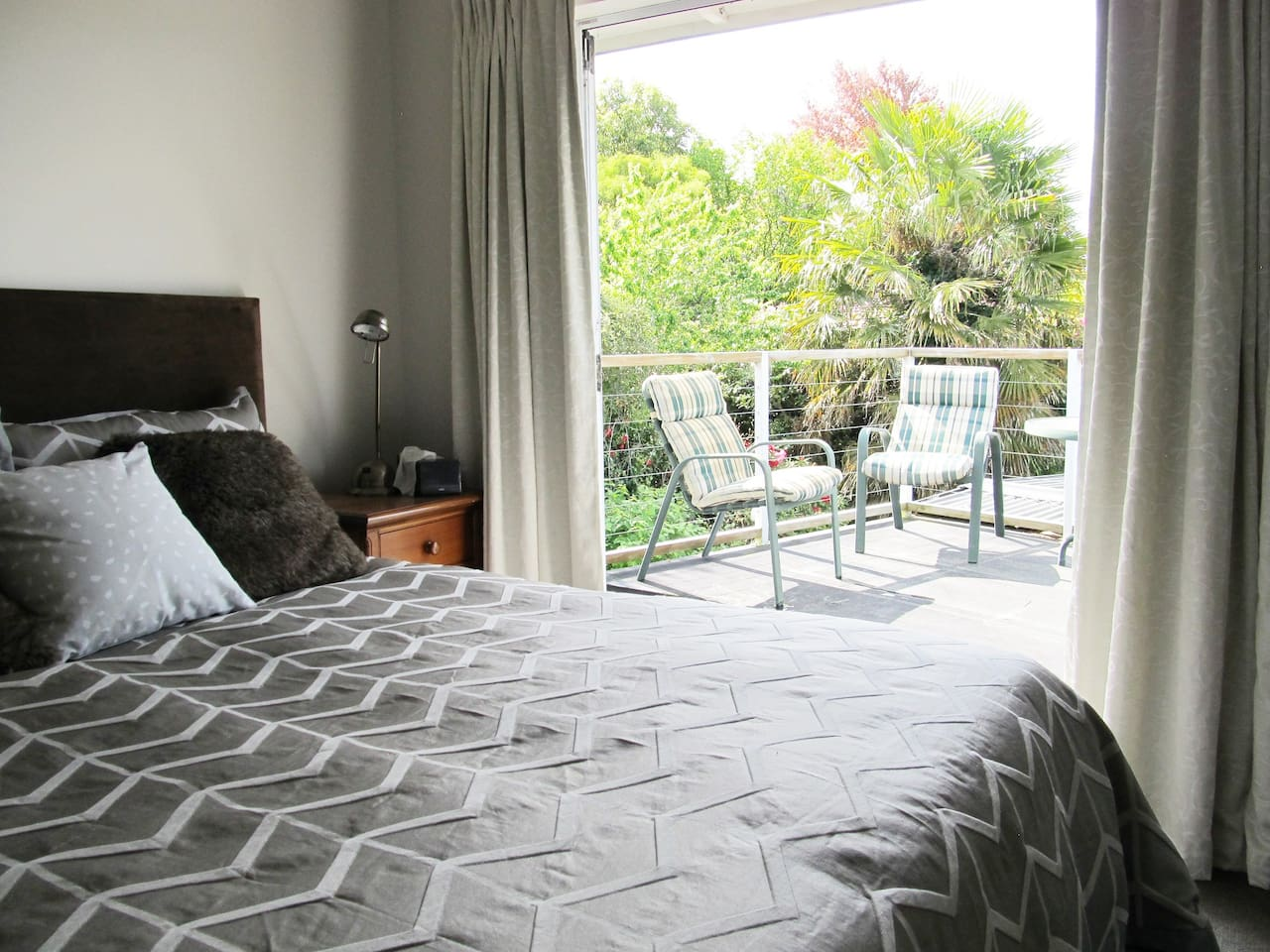 Master bedroom opens to sunny balcony