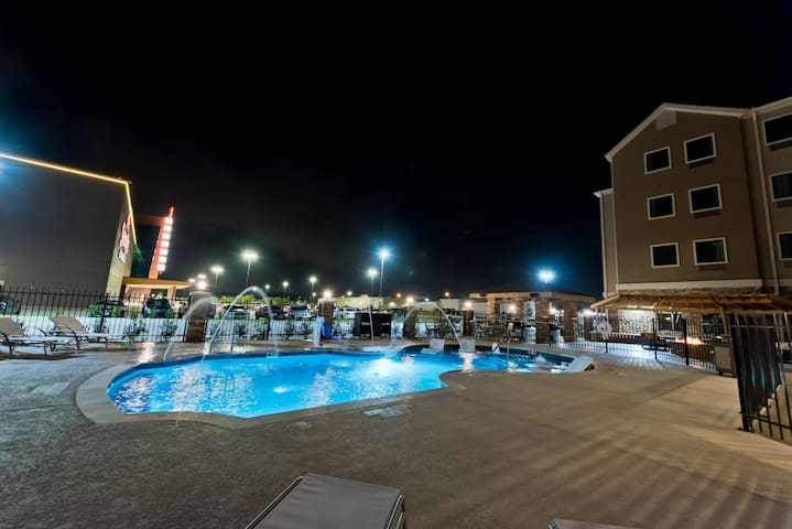 Suite with Air-Conditioning + Complimentary Breakfast   Pool Access Included!