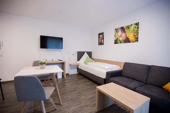 Schoko Apartments Einzelzimmer mit Balkon