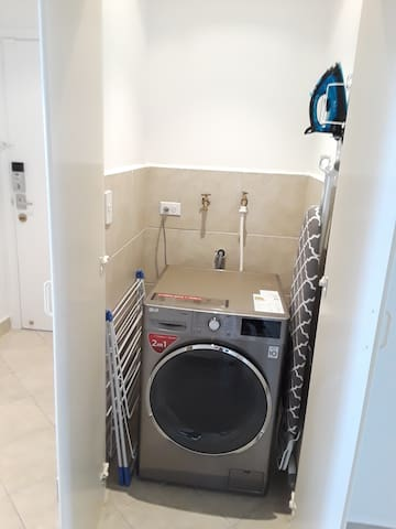 A combination washer/dryer, drying rack, iron and ironing board. All you need to keep your clothes clean and fresh. Instructions on use included in house manual.