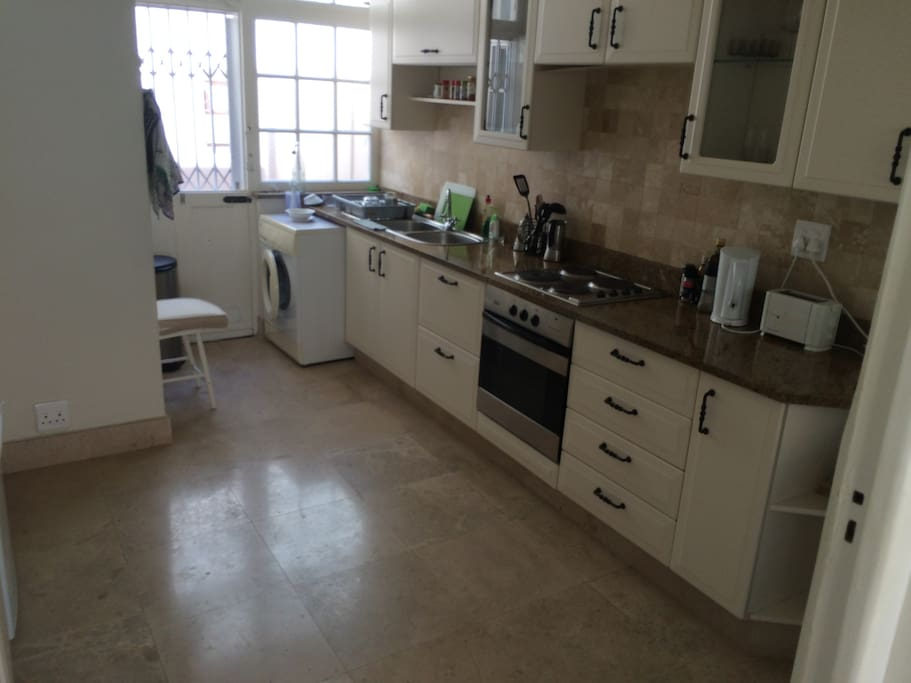 Very spacious kitchen with all appliances and separate table and corner for eating. Also outside space for laundry or taking in a glimpse of Lions Head