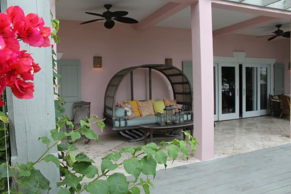 Great outdoor living space in the front and rear of the house. Choose from roomy chaise lounges to a rocking chair.