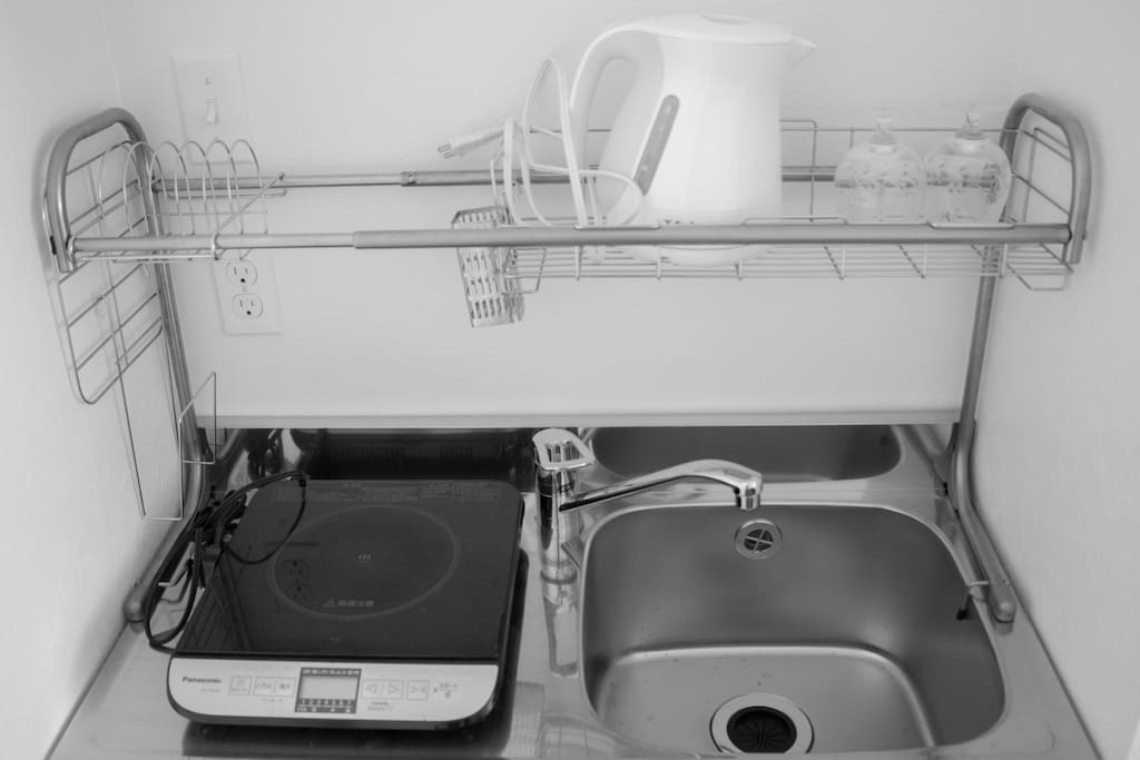 Small kitchen with IH heater, sink, T-fal, glasses, dishes, pans
