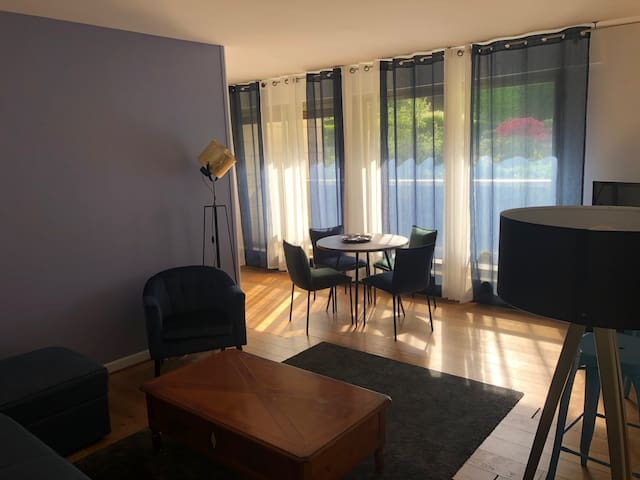 The sunny living room with its 4 people table