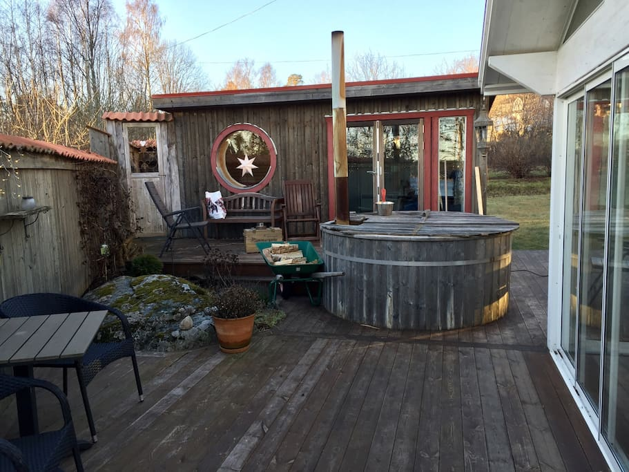 The terrace holds a wood fired hot tub and outdoor shower. The small house holds a fully equipped bathroom, sauna, and relax area with a double queen size bed