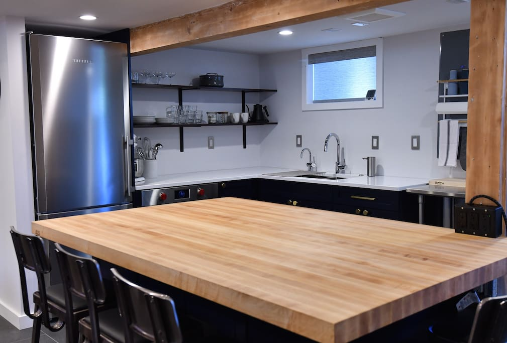 Large 4' x 6' maple Boos butcher block island for food prep and eating.