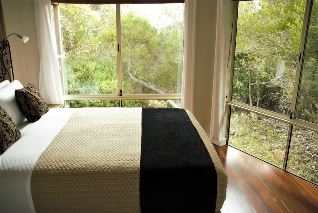 Awaken Bedroom 1 adjoins the large bathroom with a shower over 2 person spa bath which also adjoins the other bedroom.