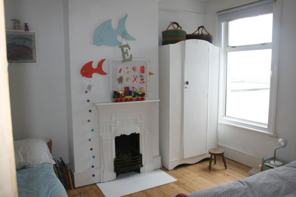 Childrens' room with one normal single and one small child's bed