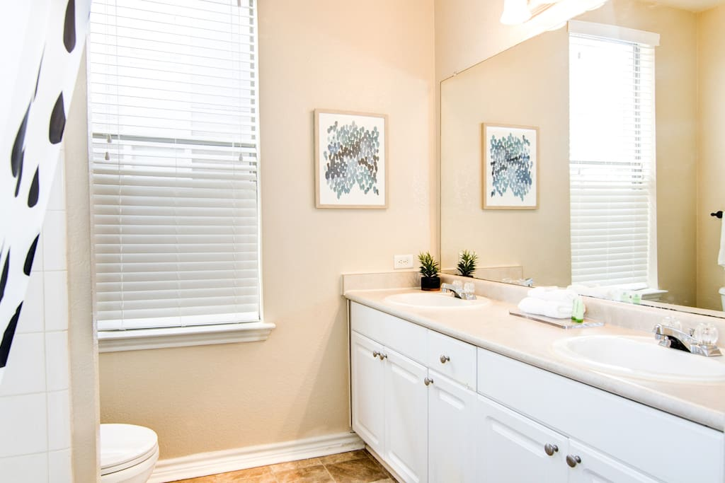 Large ensuite Master Bath w/ deep bathtub, separate shower + double sink vanity