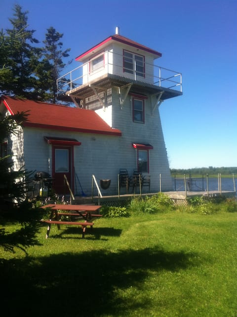 Unique lighthouse with river views