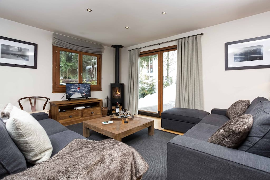 Cosy living room with wood burning stove and terrace doors