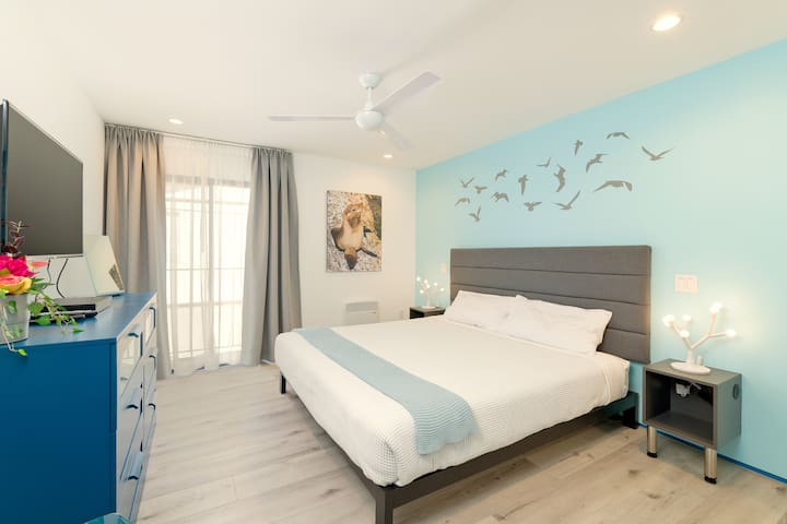 Enjoy the spacious Master Suite with a comfortable King sized bed and a small private balcony. Lights and ceiling fan can be controlled from either side of the bed. The night stands have built-in USB ports to charge your devices.