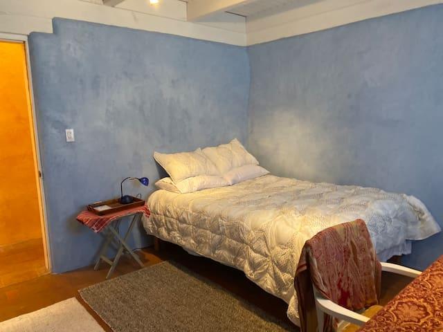 The Afghan blue bedroom..red top plaster