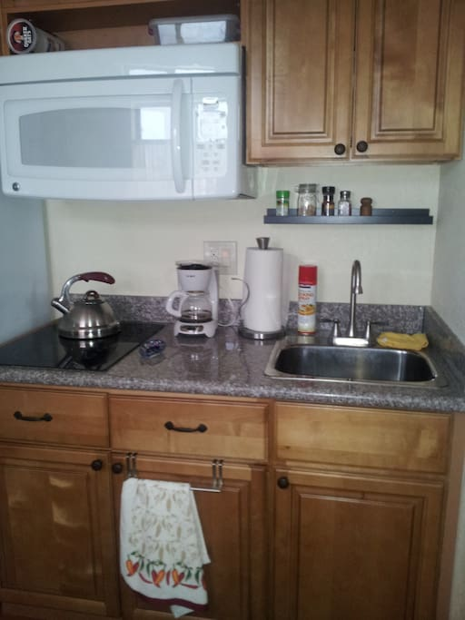 Self contained kitchenette with pots/pans, dishes, cooking essentials.  If it's not there, just ask--I probably have it.