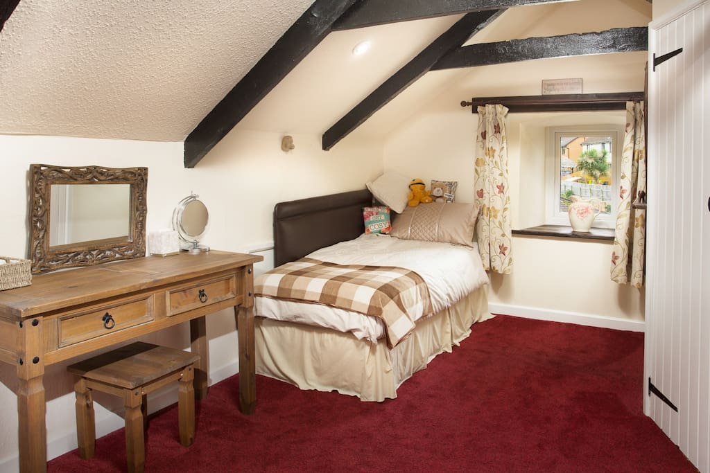 Single bed in attic room