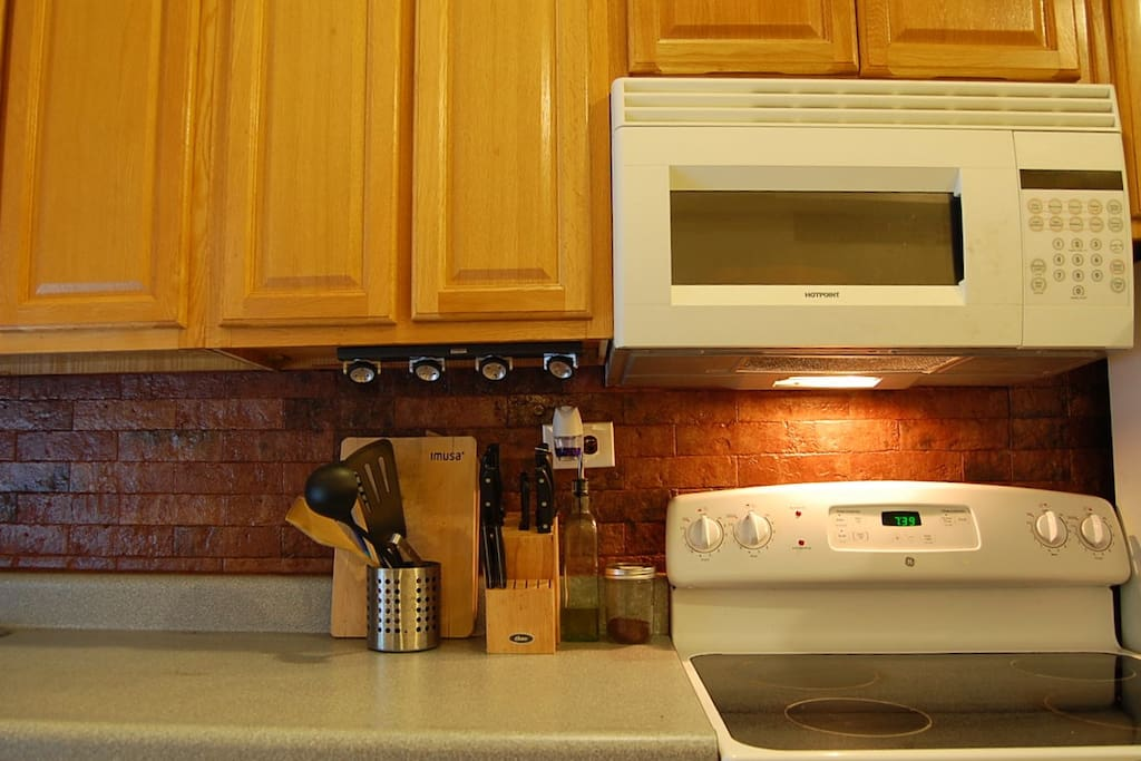 Gourmet kitchen, electric stove & microwave.