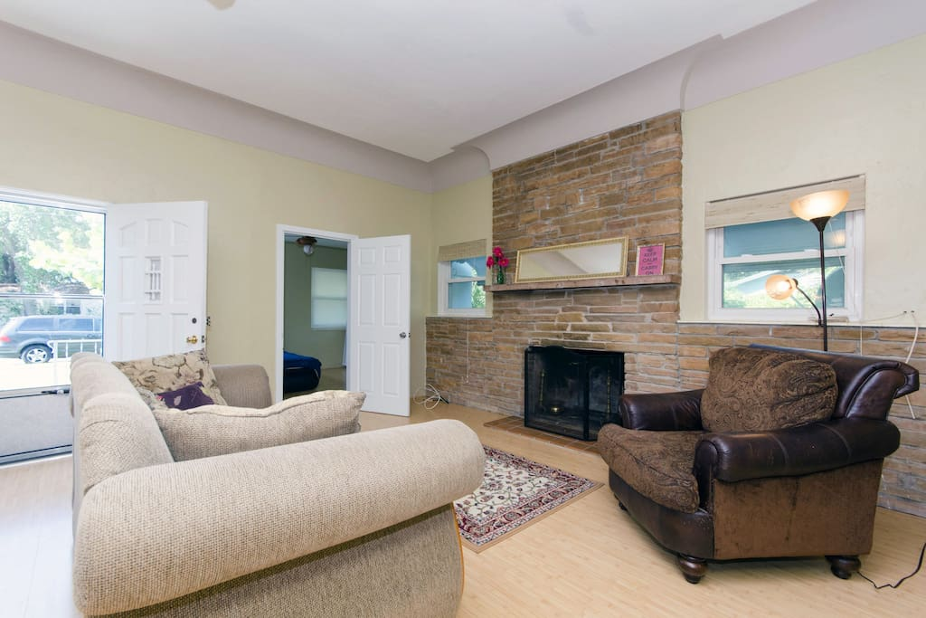 Here is another view of the living area with fireplace, go ahead an kick back in the wide arm chair