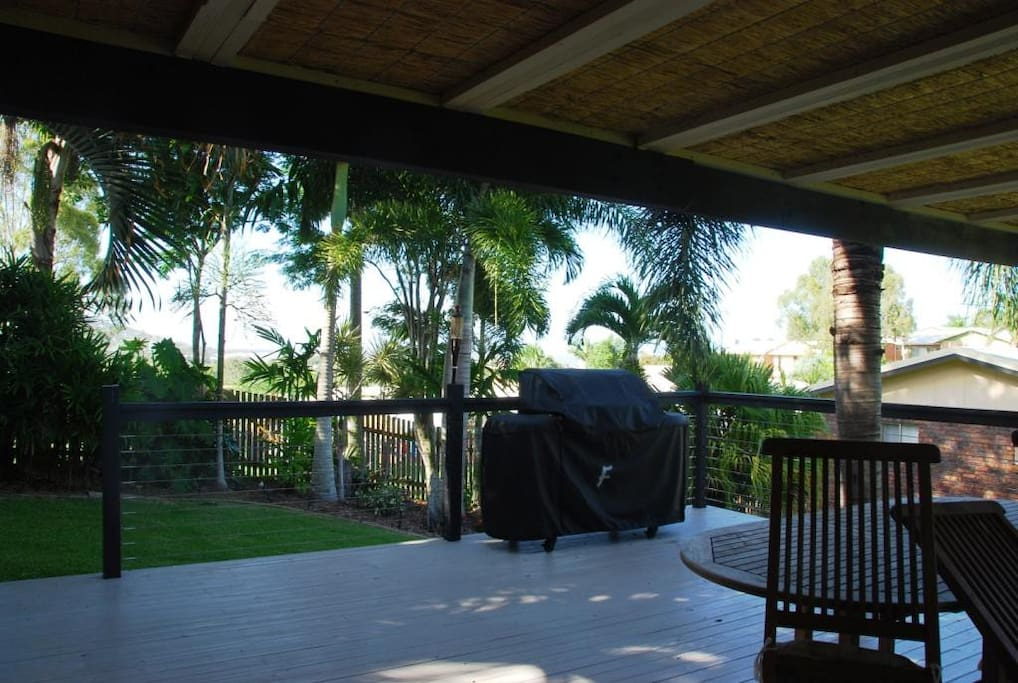 Entertainment Deck: Sea views, BBQ, spa, partly under cover, table and chairs, tropical gardens.