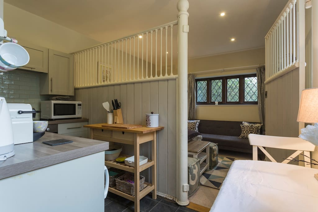 The cast iron stable stall divides the bedroom and kitchen areas.
