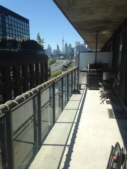 Great view of CN tower on large balcony