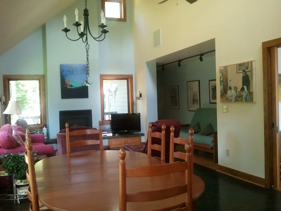 Spacious dining area ideal for family meals. Home decorated with family of artists work.