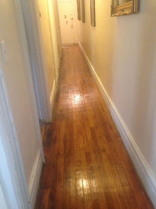 long hallway with hardwood floors