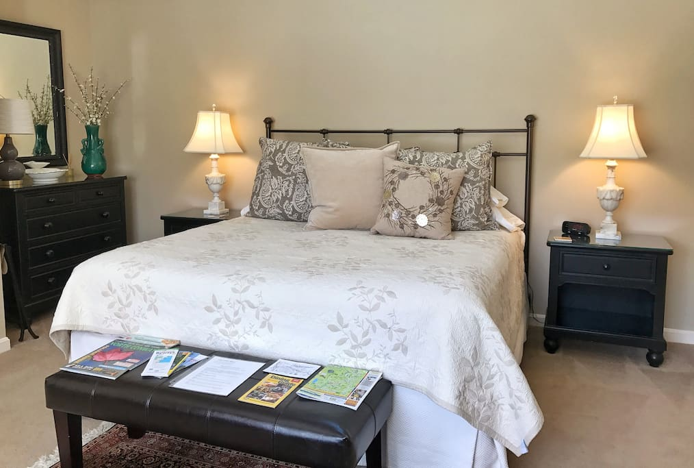Romantic bedroom with quality bedding by Garnet Hill and Pottery Barn. Lots of alternative down pillows for sleeping. And yes, we provide you with maps and brochures of the area!