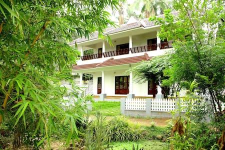 Amritham Holidays Homestay
