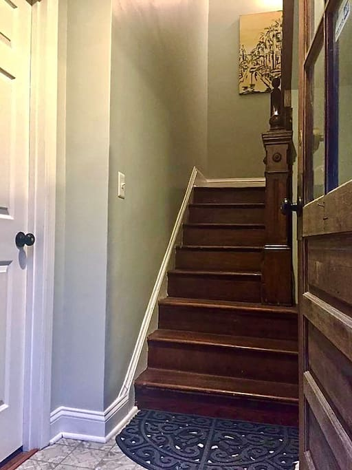The original wood staircase leads you past gallery worthy original art and up to the top two floors.