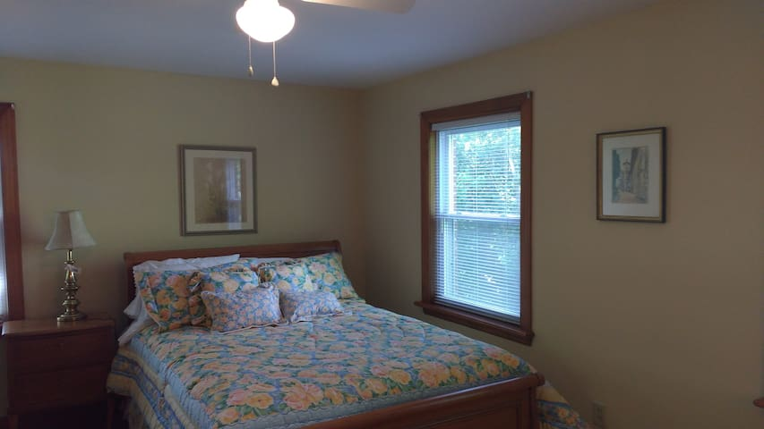 Queen bed with plenty of natural light.
