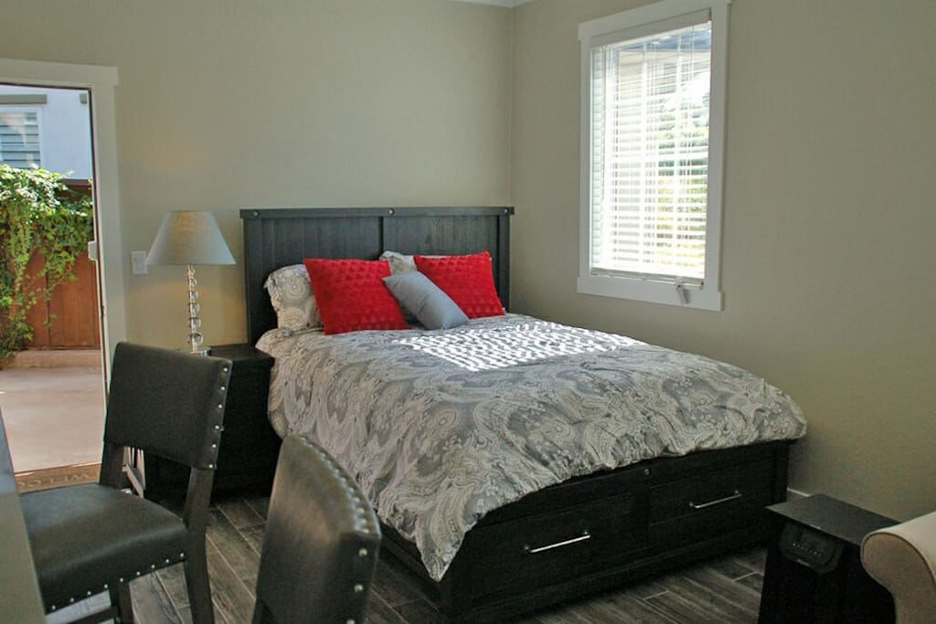 High end Queen Bed with high thread count bedding.