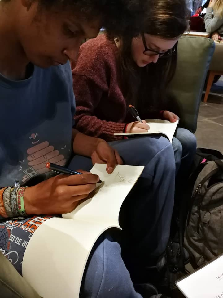 Hand-made sketchbook and pens provided
