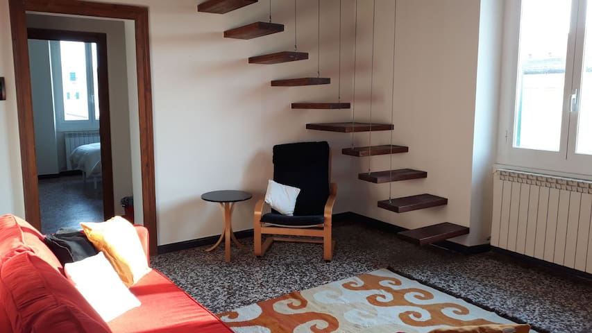 Cozy attic with suspended staircase