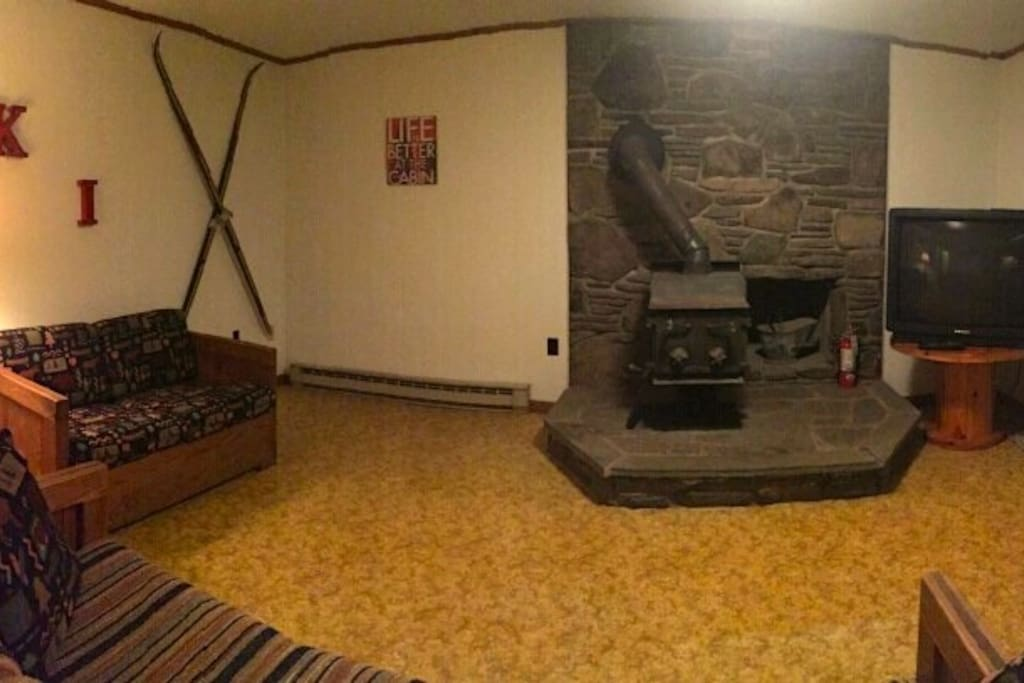 Wood burning stove, couch and TV  in living room
