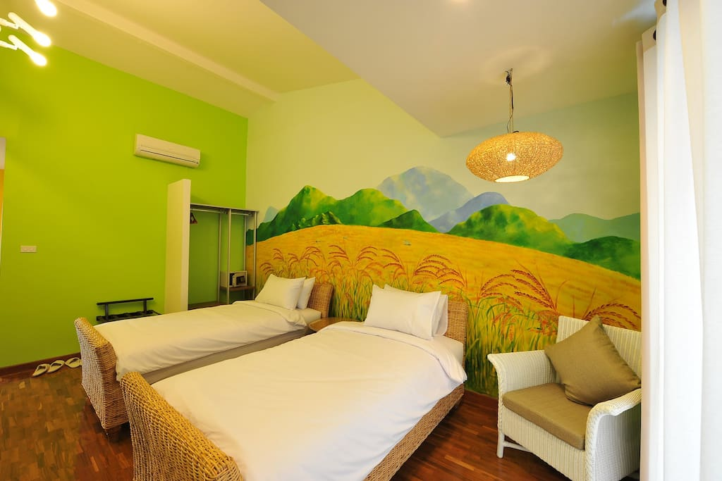 Rice Field Room, wall painted, cable TV, air-con, balcony, hot shower, free wi-fi, wooden floor, 2 single beds and inclusive of breakfast
