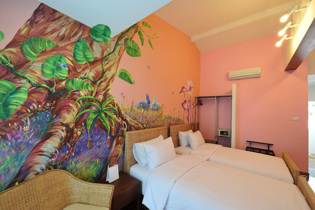 Rain Forest Room, wall painted, cable TV, air-con, balcony, free wi-fi, wooden floor, 2 single beds and inclusive of breakfast