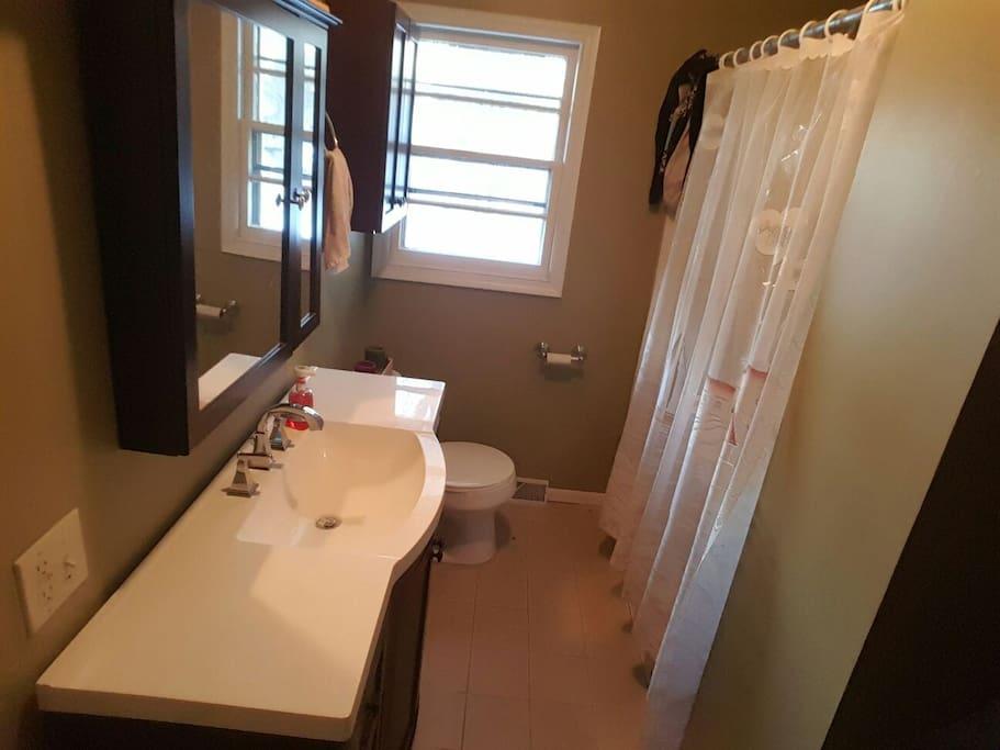 Newly finished full bath with shower/bathtub.