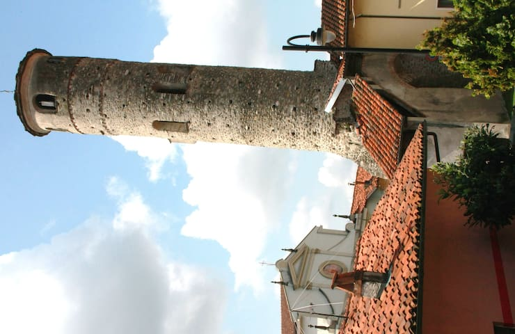 UNDER THE MIDDLE AGE TOWER THE HEART OF PIEDMONT
