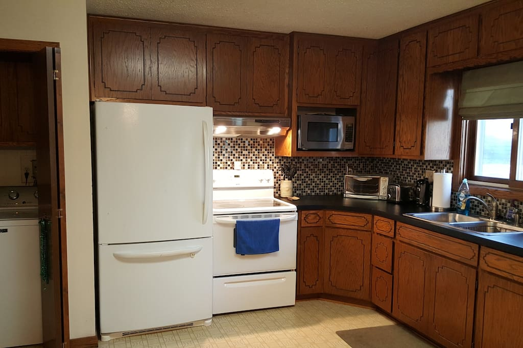 Partial View of Kitchen, Nearby Washing Machine and Dryer,