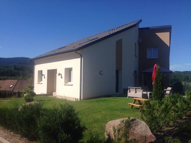 Maison d'architecte avec une vue magnifique.