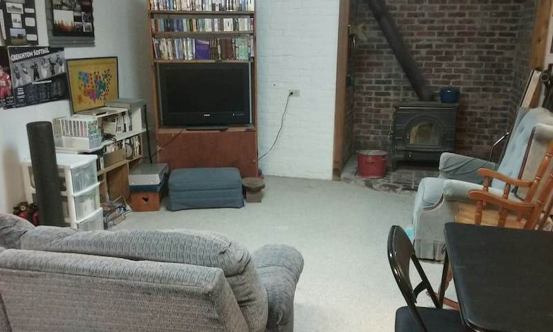 Cozy family room with TV and table and chairs for games or computer work