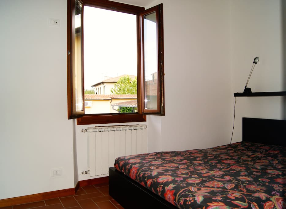 Bedroom w/double bed; view on Monte Morello and the Medici villa of Petraia