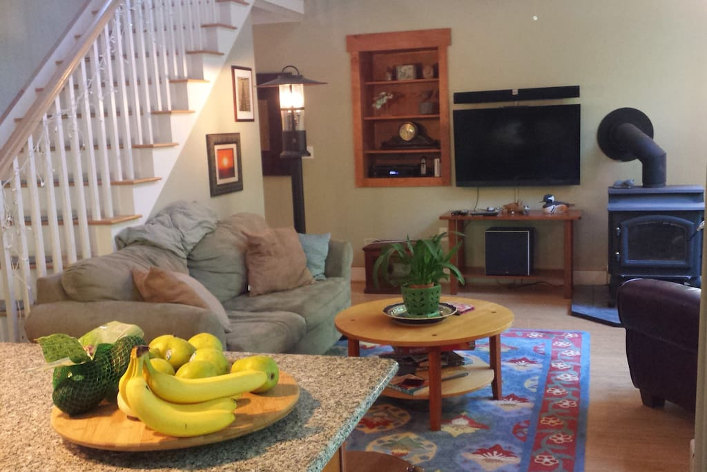 Living room with cherry furniture, bamboo floors,  pull out couch.