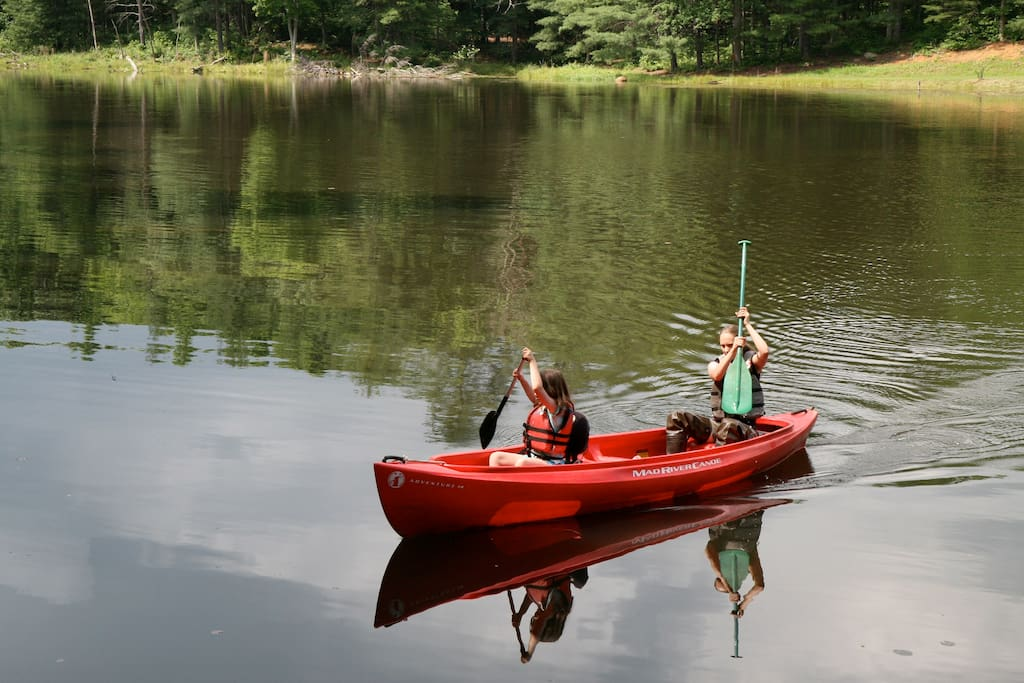 2 canoes on site for guests to explore the lake.