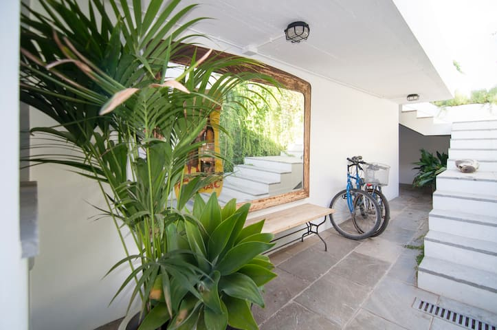 THE MAIN ENTRANCE AND BIKES AT YOUR DISPOSAL. Only this entrance will be shared for hosts and guests.