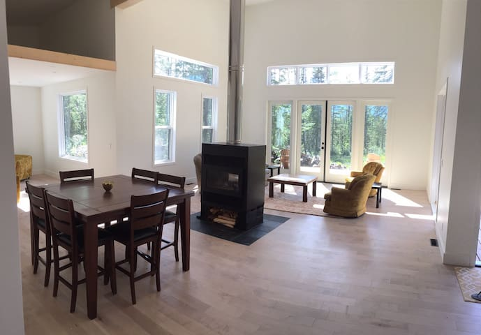 Living room and dining room with double sided fireplace