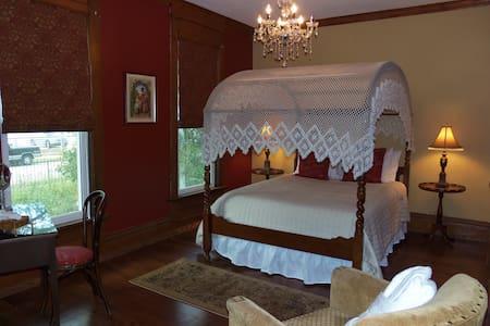 The Treaty Suite Bedroom with Queen canopy bed, full closet, antique vanity